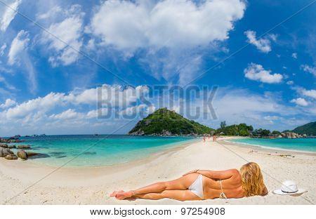 Woman laying on Nang Yuan island of Koh Tao island Thailand
