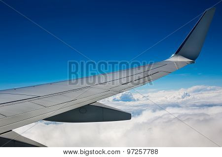 Airplane Wing On Sky Background