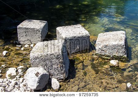 Photo of square stones among water
