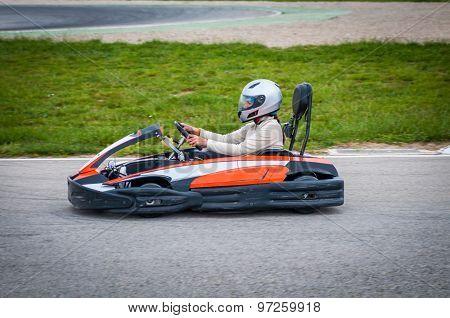 Woman Driving A Kart