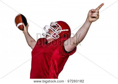 A triumph of an american football player with black background