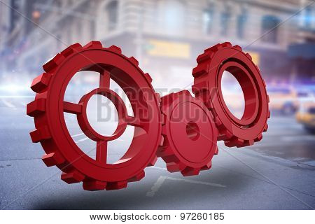 Red cog and wheel against blurred new york street