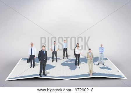 Business team against world map