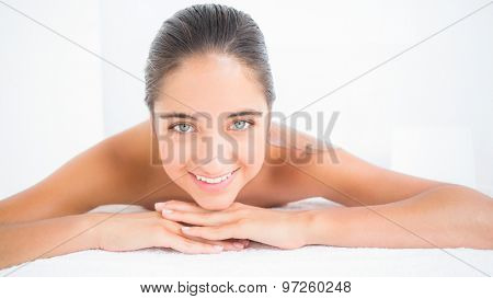 Beautiful brunette enjoying a chocolate beauty treatment at the health spa