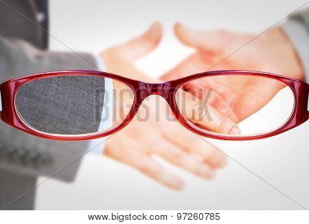 Two people going to shake their hands against glasses