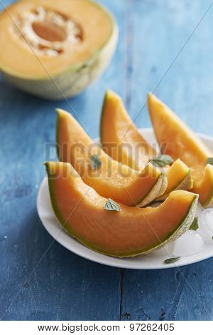 Cantaloupe melon with mint and ice