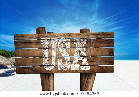 USA wooden sign on the beach