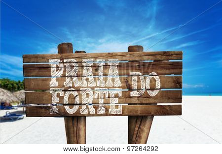 Praia do Forte wooden sign on the beach
