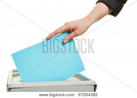 Female hand casting vote at election with ballot paper at box
