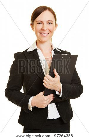Smiling business woman holding a clipboard in her hands