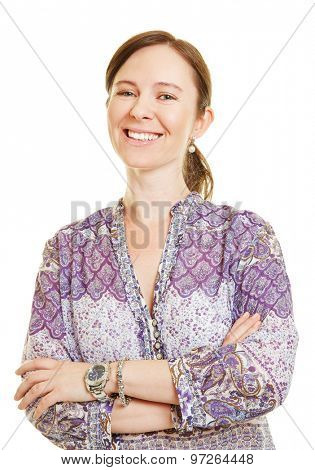 Smiling happy attractive woman with her arms crossed