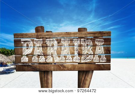 Pariah wooden sign on the beach
