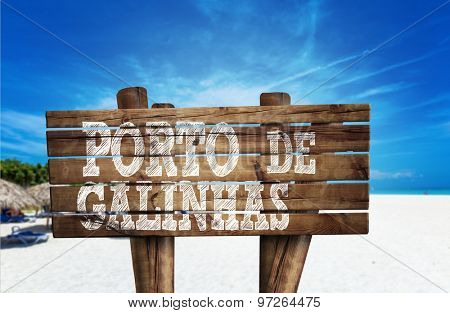 Puerto de Galinhas wooden sign on the beach