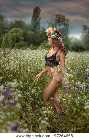 Half-naked Girl Standing In A Field.