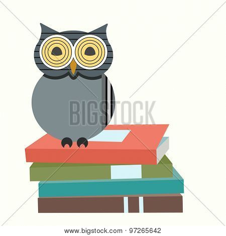 Wise owl on stack of books