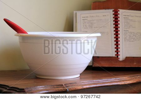 White mixing bowl with spoon