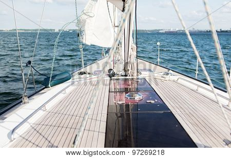 vacation, travel, cruise and leisure concept - close up of sailboat or sailing yacht deck and sea