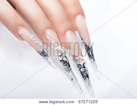 Human fingers with long fingernail and beautiful manicure over gray