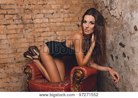 Sexy Girl Posing On The Red Chair