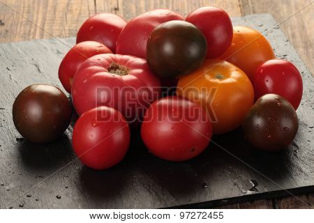 Heap of tomatoes on a slate board