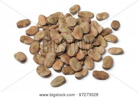 Heap of dried broad beans on white background