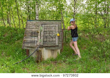 Girl In Wooden Well