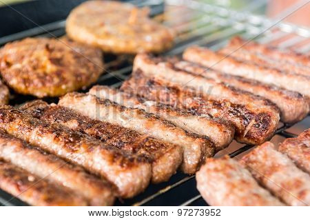 Tasty meat on a barbeque.
