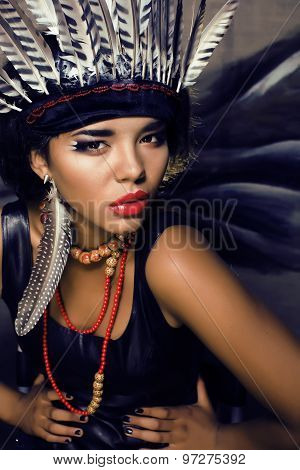 young pretty woman with make up like red indian, halloween teem