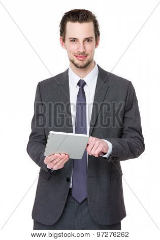 Young businessman use of digital tablet