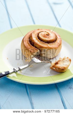 cinnamon bun on kitchen table