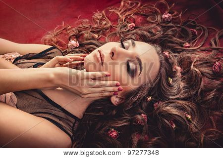 Girl Lying With Flowers On Hair. Charming Girl With A Flowers. Young Woman Has A Beautiful Face.