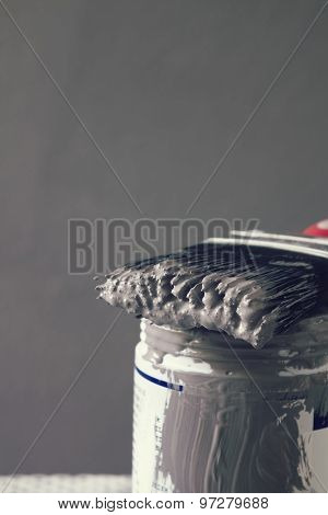 Close Up Of Wet Paint On Brush On Sample Pot Vertical