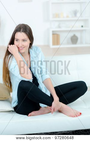 Young brunette chilling out at home