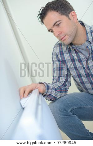 Kneeling by a radiator