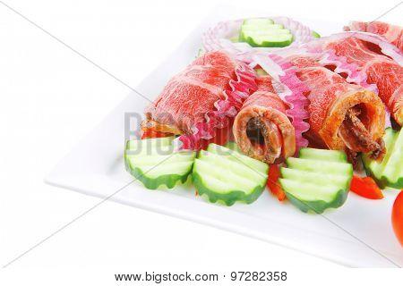 fresh roasted meat rolls on white platter