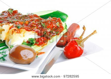 cheese cannelloni served with vegetables on square plate