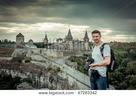 Portrait of young man  on the background of an old fortress in Kamenetz-Podolsk