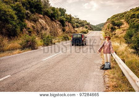 Angry and disappointed woman hitchhiker