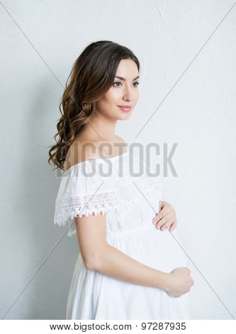 Beautiful pregnant woman on white background.