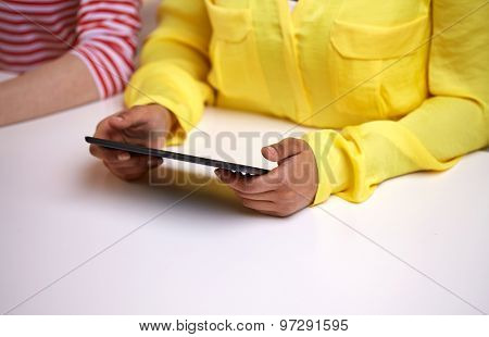people, technology and internet concept - close up of african american female hands with tablet pc at table