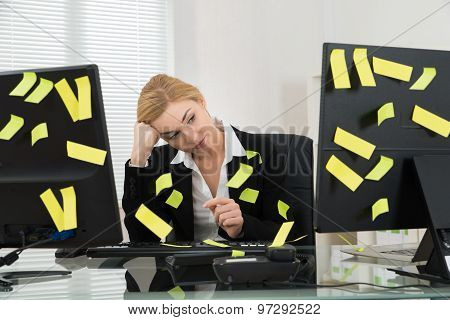 Businesswoman With Adhesive Notes In Office