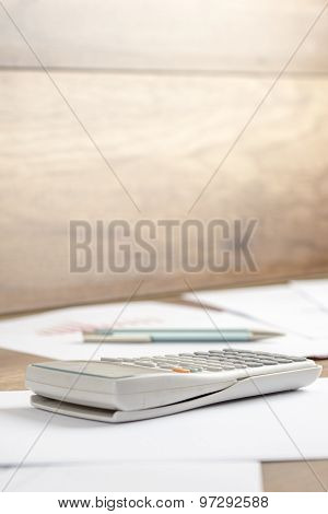 White Plastic Desk Calculator On A Printed Document