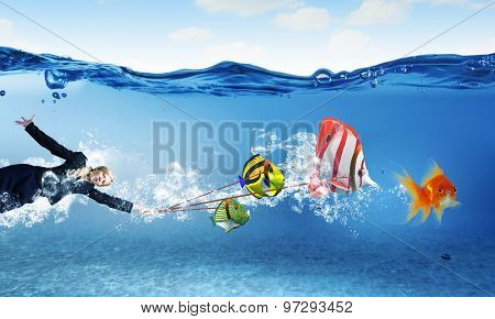 Young businesswoman and big exotic fish. Success in business