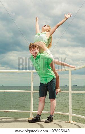 Couple In Love Having Fun On Sea Pier