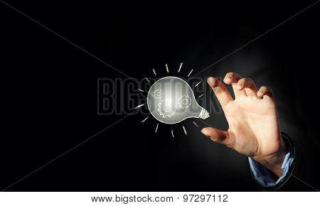 Close up of businessman holding symbol of  light bulb