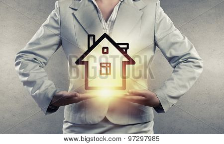 Close up of businesswoman holding in hands house model