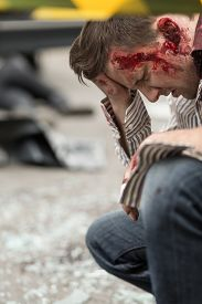 pic of accident victim  - Image of bloody man after road accident - JPG