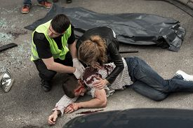 foto of corpses  - Corpse of young man lying on the street - JPG