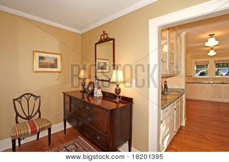 Hallway Corner With Mirror And Kitchen