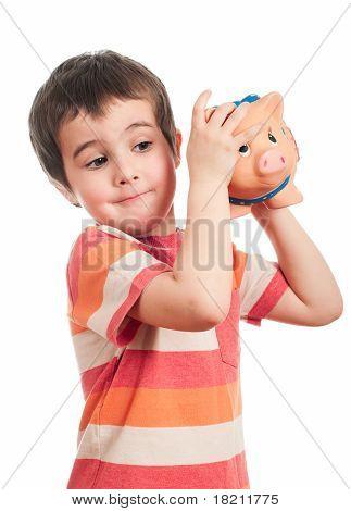 Little Boy Shaking The Piggy Bank
